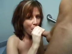 She goes into bathroom to engulf jock