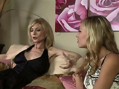 The luxurious milf pornstar Nina Hartley adores young girls and when this babe sees this pretty college bimbo Nicole Ray this babe makes a decision to seduce her in any possible way