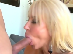 Provocative cock hungry experienced mature blonde whore Erica Lauren with big tits and fantastic oral skills gets turned on and enjoys pleasuring young muscled stud with unbending cock