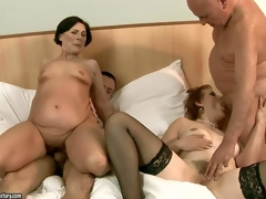 Margo T and Eodit are two lascivious grannies that acquire their mouths and trickling soaked pussies fucked side by side. 2 fuck hungry oldies do it on a king size bed in steamy foursome action!
