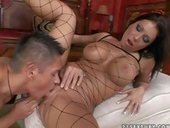 Attractive tanned black haired milf with round firm hooters and smoking hot body in fishnet full body stockings and high heels gets licked and boned to orgasm by young turned on buck