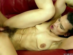 Slender dark haired mature woman Susy receives turned up by young guy before she widens her slender legs wide and receives her wet hairy pussy filled with his hard dick. See slender granny receive hard screwed