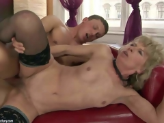 Margarette is s slim slutty granny with tiny tits and curly snatch. Mature woman in dark stockings gets her fuck hole filled with youthful stiff cock. Watch her engulf and receive gangbanged on the ottoman