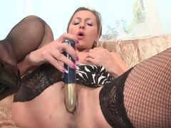 Lean mature hottie in black fishnets masturbates