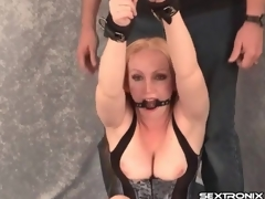 Bound and gagged milf in taut corset