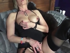 Darksome boots and lingerie on sexy golden-haired aged