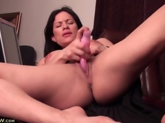 Large clit milf has sex with a pink dildo
