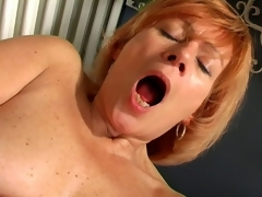 Charming granny Lady widens pussy and fucks a biggest white vibrator
