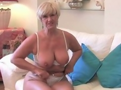 Blonde granny plays with the brush pussy