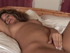 MILF Emanuelle masturbating in her bed